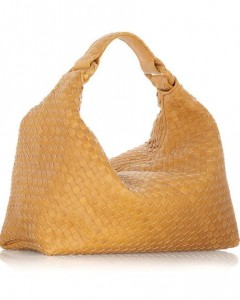 "Hobo Bag: a large crescent-shaped shoulder bag or any large bag that hangs from your shoulder and has a main compartment closure (unlike the ""tote"" which is normally open top)."