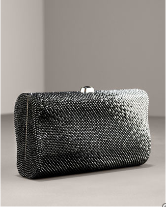 Minaudiere: a small evening bag embezzled with pieces of metal, semi precious stones or beads or covered with fabric or leather.
