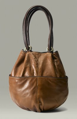 Bucket bag: roomy bag shaped like a bucket, usually has an open top and shoulder strap.